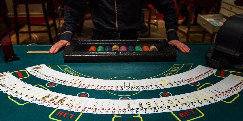 Dealer hands out cards